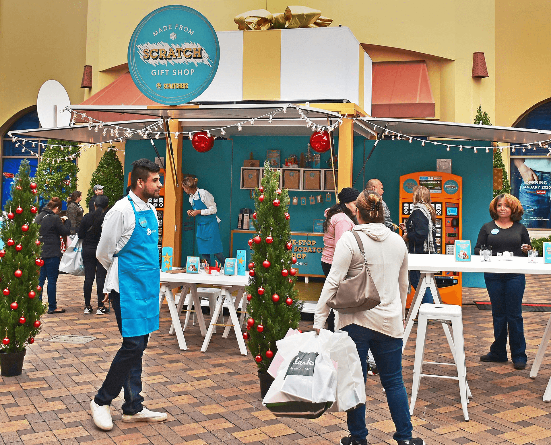 A pop-up shop wrapped like a gift and opened each day for a merry experience for CA Lottery and those looking for a fun break from their holiday hustle.