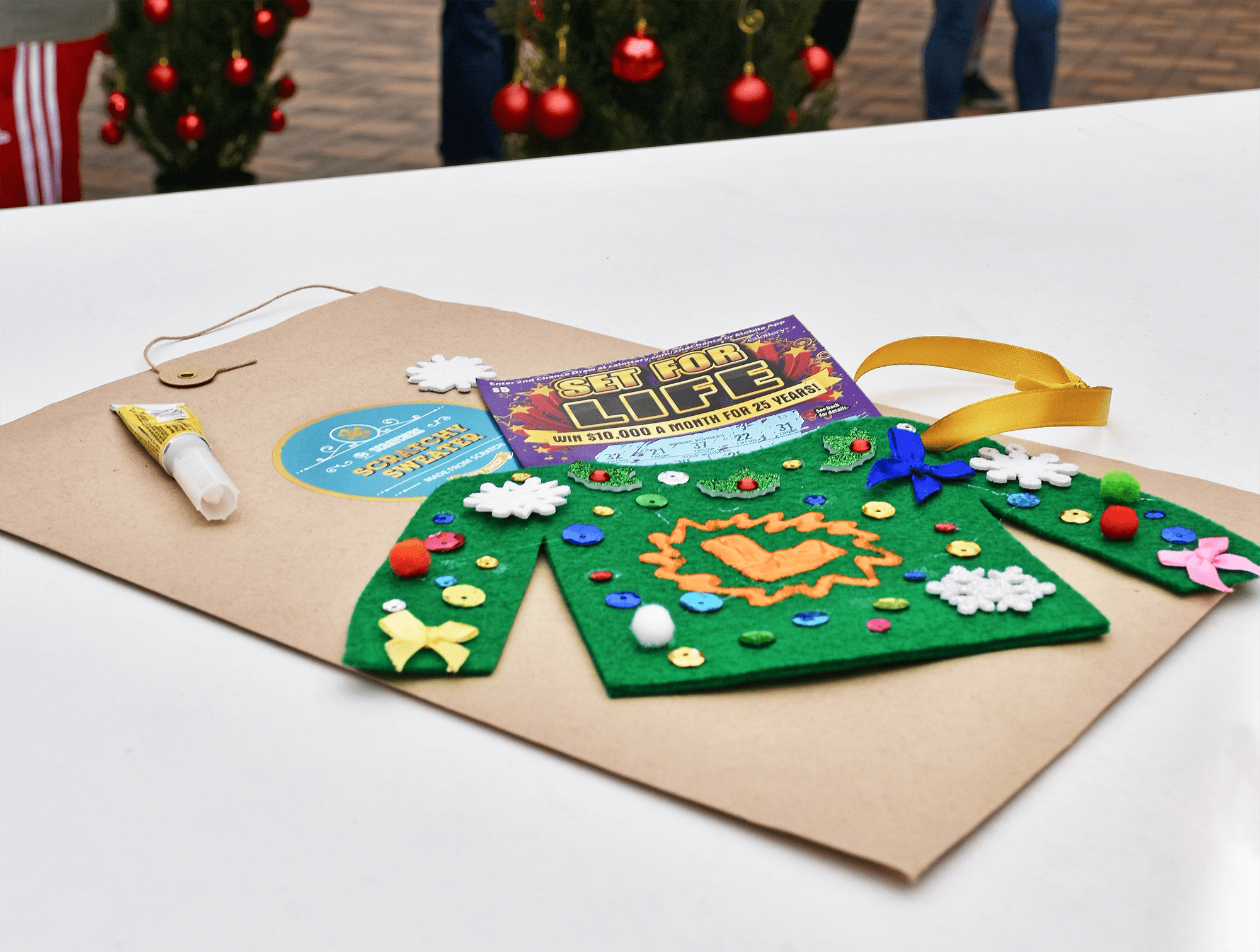 """Each of the 5 kits was designed to enhance the joy of Scratchers<sup>®</sup>. For example, a """"Scratchy Holiday Sweater"""" that you could bedazzle with the accompanying decorations also became a snug holder for the Scratchers ticket itself."""